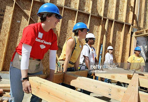 Habitat for Humanity volunteers lift a wall frame as they help build a home April 16 2010 in Oakland California Habitat for Humanity East Bay kicked...