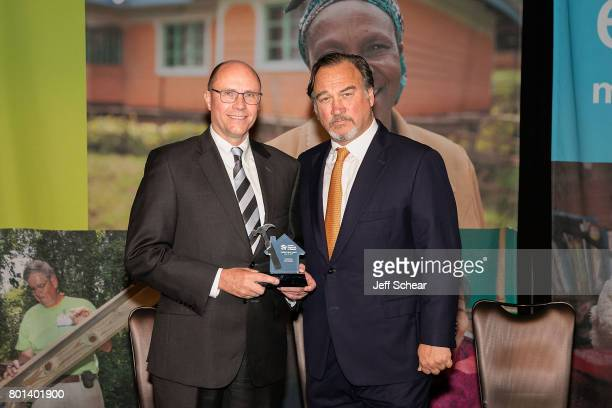 Habitat Hero Ted Dosch with special guest and DuPage native Jim Belushi at the Habitat Hero Award Dinner held June 13 2017 at the Loews Chicago Hotel...