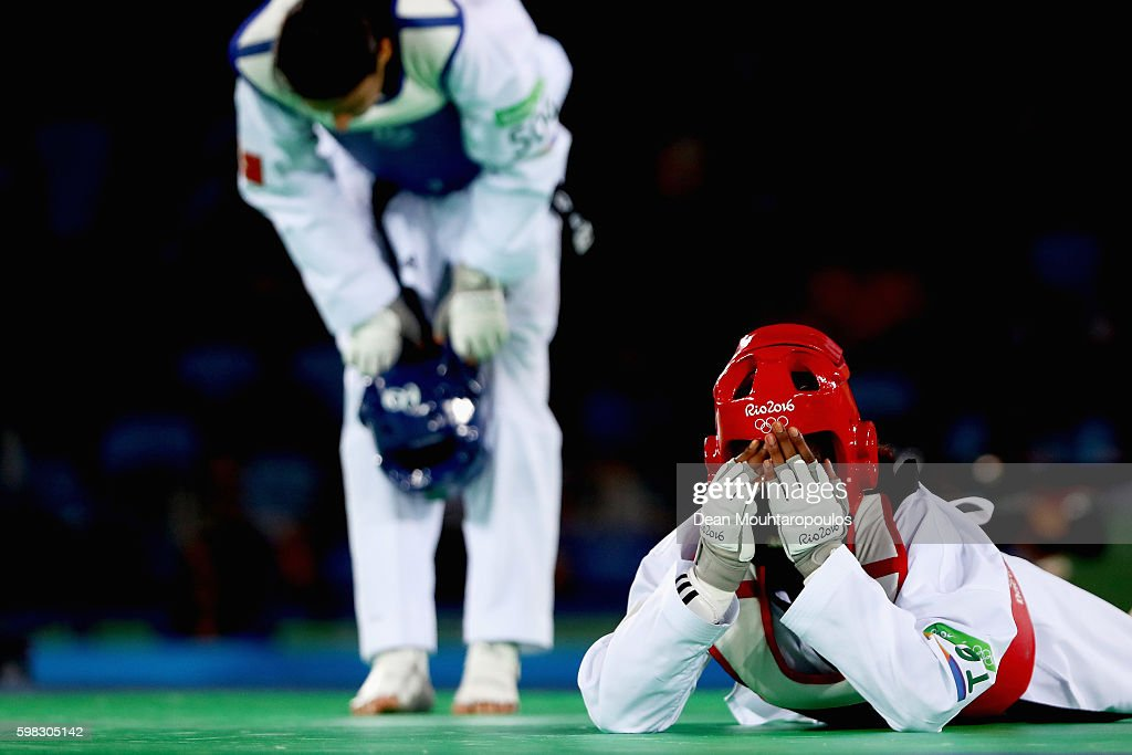 Haby Niare (red cap) of France celebrates victory against Nur Tatar of Turkey after they compete in their Women's -67kg Taekwondo semifinal bout on Day 14 of the Rio 2016 Olympic Games at Carioca Arena 3 on August 19, 2016 in Rio de Janeiro, Brazil