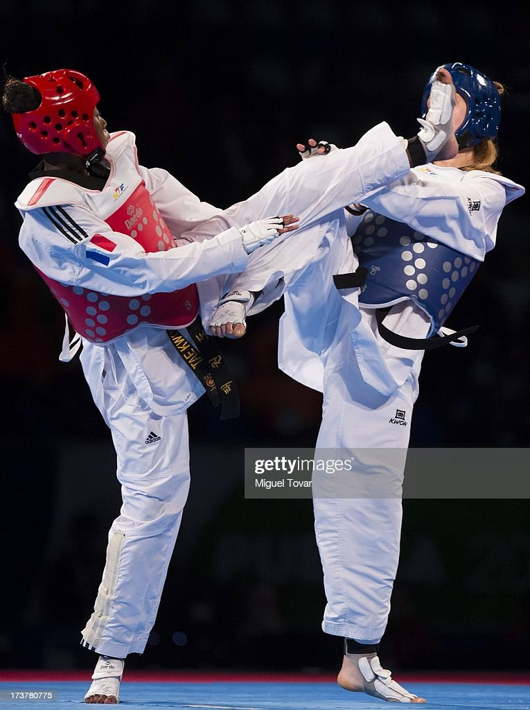 Haby Niare of France (red) competes with Franka Anic of Slovenia (blue) during a Wome's -67 kg combat of WTF World Taekwondo Championships 2013 at the exhibitions Center on July 17, 2013 in Puebla, Mexico.