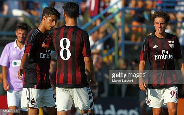 Hachim Mastour of AC Milan celebrates with his teammate Jesus Joaquin Fernandez Saenz Suso 8 after scoring his goal during the preseason friendly...
