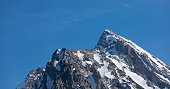 The Hochkalter mountain peak in  ramsau on a spring day with bright blue sky