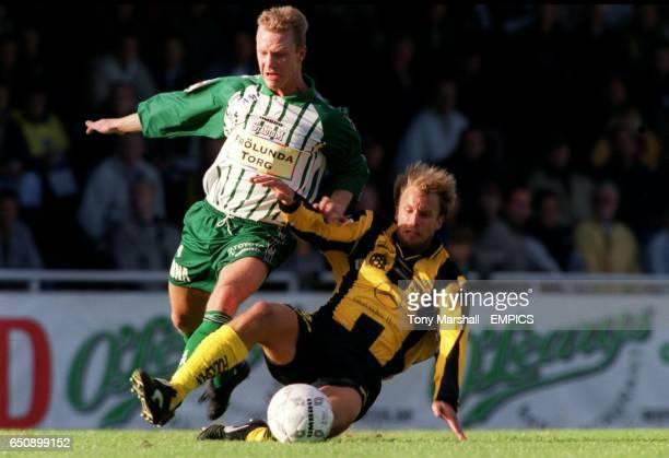 BK Hacken's Henrik Dahl tackles Vastra Frolunda's Bjorn Lundberg
