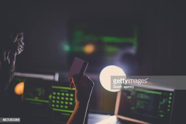 Hacker holding credit card