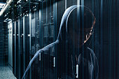 hacker sneaking in the internet network data center