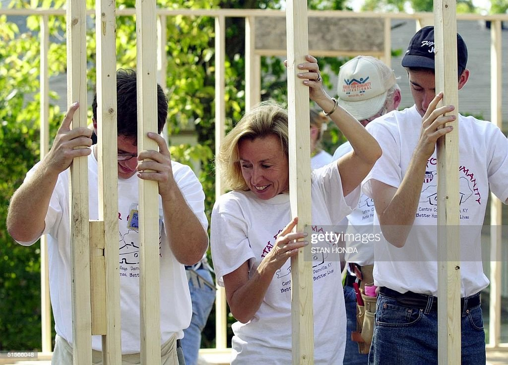 Hadassah Lieberman and her son Ethan help Centre College's Habitat for Humanity construction manager Ross Todd with a wall frame 05 October 2000 at a...