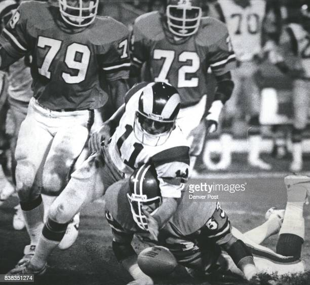 Haden fumbles when running out of pocket He recovered his own 4th period fumble #63 John Giant 79 Barney Chavous and 72 Don La Times Credit Denver...