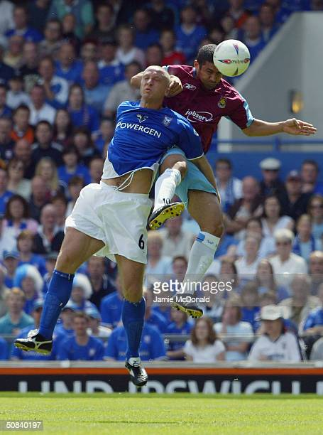 Haden Mullins of West Ham jumps with Matt Elliott of Ipswich during the Nationwide Division One playoff SemiFinal between Ipswich Town and West Ham...