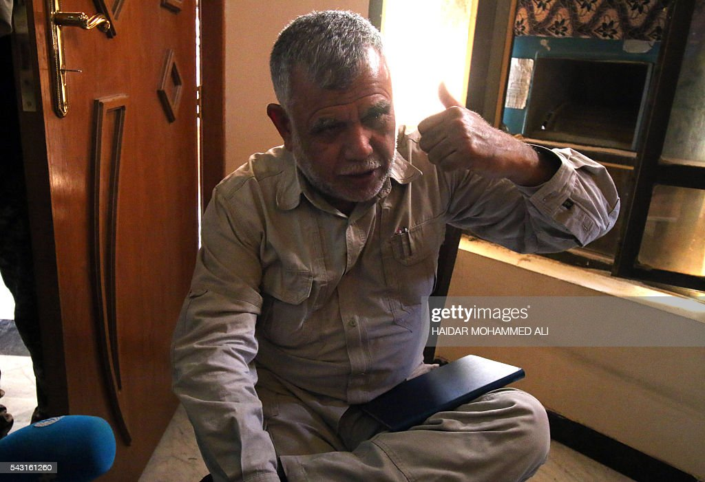 Hadi al-Ameri, a commander of Hashed al-Shaabi, an Iraqi paramilitary umbrella that is dominated by Shiite militias, gestures as he speaks to journalists in Fallujah, 50 kilometres (30 miles) from the capital Baghdad, after Iraqi forces retook the embattled city from the Islamic State group on June 26, 2016. Iraqi forces took the Islamic State group's last positions in the city of Fallujah , establishing full control over one of the jihadists' most emblematic bastions after a month-long operation / AFP / HAIDAR