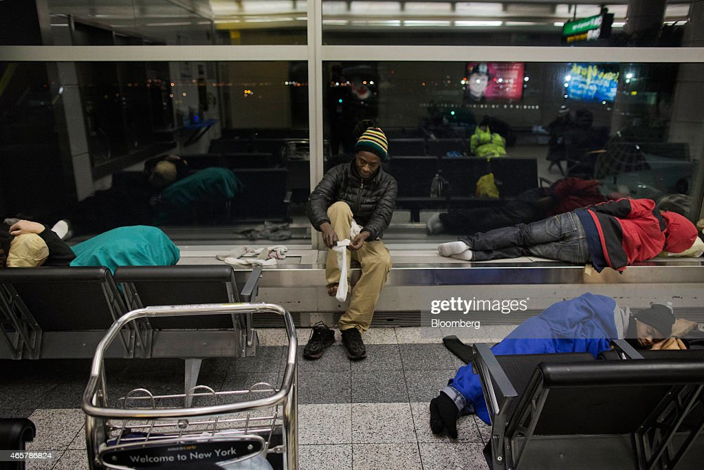 Hadi Mansaray who is homeless puts his socks on in Terminal B of LaGuardia Airport in New York on Saturday March 7 2015 While the homeless population...