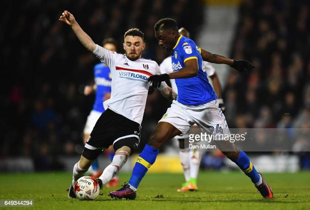 Hadi Sacko of Leeds United is challenged by Scott Malone of Fulham during the Sky Bet Championship match between Fulham and Leeds United at Craven...
