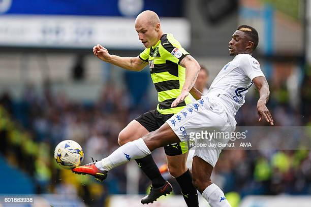 Hadi Sacko of Leeds United tackles Aaron Mooy of Huddersfield Town during the Sky Bet Championship fixture between Leeds United and Huddersfield Town...