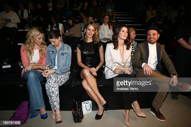 Hadise her sister Bade Iscil Beren Saat and Kenan Dogulu attend the Soul By Ozgur Masur show during Mercedes Benz Fashion Week Istanbul Fall/Winter...