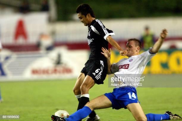 Hadjuk Split's Srdan Andric tackles Fulham's Junichi Inamoto