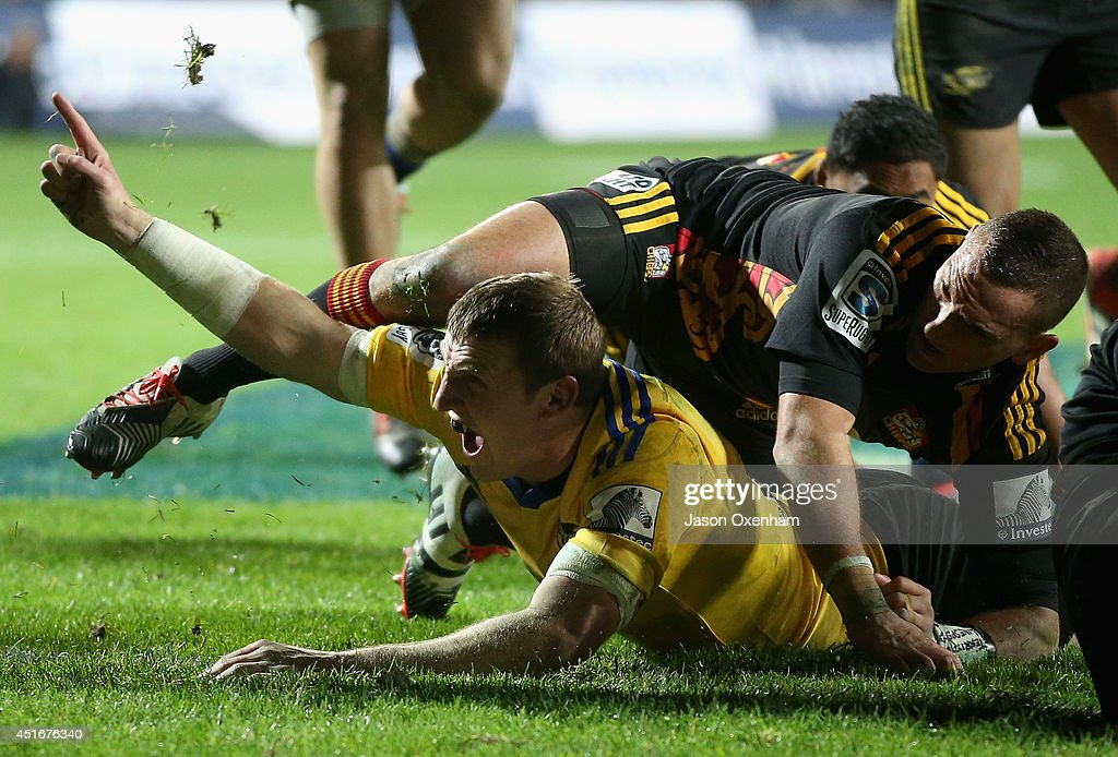 <a gi-track='captionPersonalityLinkClicked' href=/galleries/search?phrase=Hadleigh+Parkes&family=editorial&specificpeople=7128937 ng-click='$event.stopPropagation()'>Hadleigh Parkes</a> of the Hurricanes celebrates his try in the tackle of <a gi-track='captionPersonalityLinkClicked' href=/galleries/search?phrase=Aaron+Cruden&family=editorial&specificpeople=5501441 ng-click='$event.stopPropagation()'>Aaron Cruden</a> of the Chiefs during the round 18 Super Rugby match between the Chiefs and the Hurricanes at Waikato Stadium on July 4, 2014 in Hamilton, New Zealand.