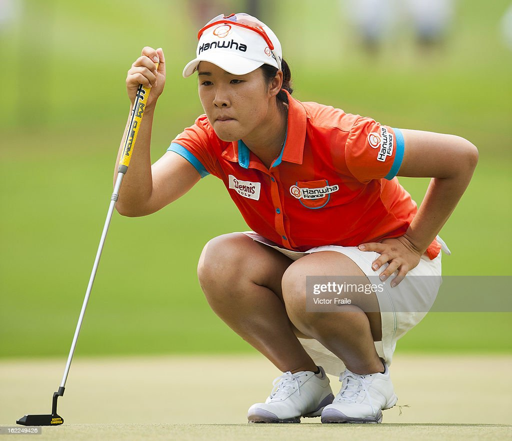 Haeji Kang of South Korea lines up a put on the 14th green during day one of the 2013 Honda LPGA Thailand at Siam Country Club on February 21, 2013 in Chon Buri, Thailand.