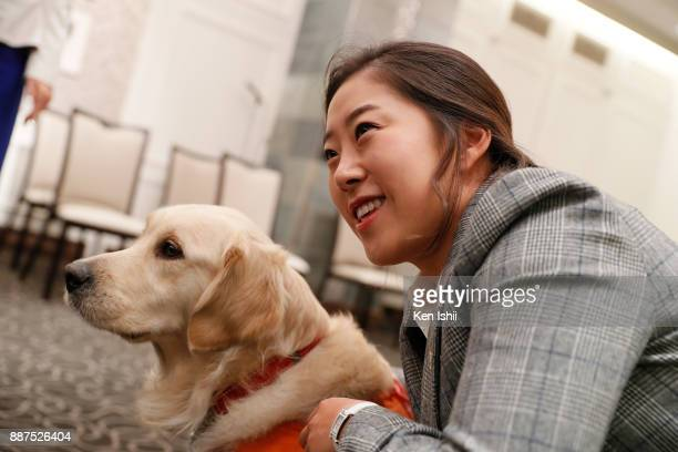 HaeRym Kim of South Korea and an assistance dog during the Ladies Professional Golfers' Association of Japan induction ceremony at Hotel Monterey...
