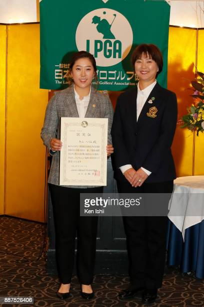 HaeRym Kim of South Korea receives a certificate from LPGA president Hiromi Kobayashi during the Ladies Professional Golfers' Association of Japan...