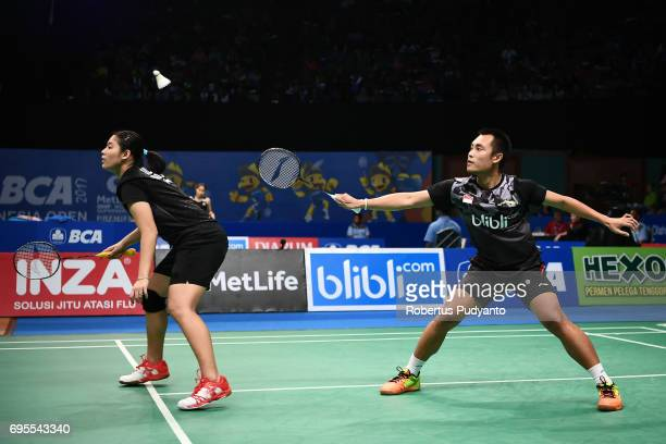 Hafiz Faizal and Shela Devi Aulia of Indonesia compete against Wang ChiLin and Lee Chia Hsin of Chinese Taipei during Mixed Doubles Round 1 match of...