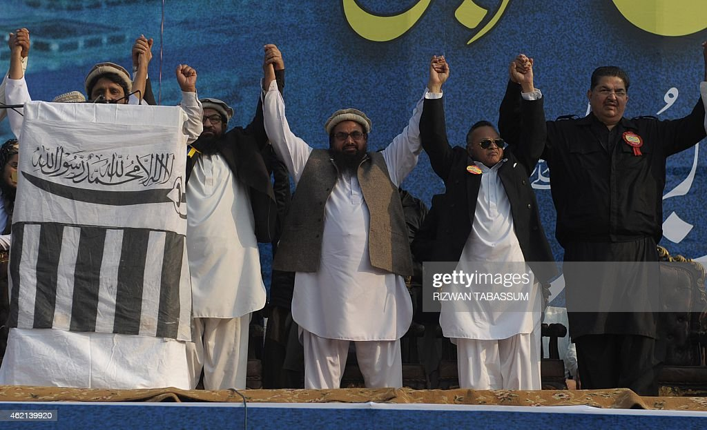 <a gi-track='captionPersonalityLinkClicked' href=/galleries/search?phrase=Hafiz+Muhammad+Saeed&family=editorial&specificpeople=5517481 ng-click='$event.stopPropagation()'>Hafiz Muhammad Saeed</a> (C), head of the banned Pakistan's charity organisation Jamaat-ud-Dawa (JuD), joins hands with other leaders during a protest against the printing of satirical sketches of the Prophet Muhammad by French magazine Charlie Hebdo in Karachi on January 25, 2015. Thousands in Pakistan continued their protests against satirical magazine Charlie Hebdo's cartoon portrayal of the Prophet Mohammed. AFP PHOTO/ Rizwan TABASSUM