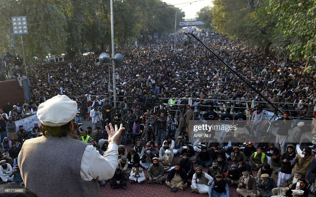 Hafiz Saeed, leader of Jamaat-ud-Dawah (JuD) Pakistan, addresses demonstrators during a protest against the printing of satirical sketches of the Prophet Muhammad by French magazine Charlie Hebdo, in Lahore on January 18, 2015. Anti-Charlie Hebdo protests continued across Pakistan as thousands of people came on streets in almost all major cities chanting slogans against the printing of cartoons of the Prophet Mohammed in the French magazine. AFP PHOTO / Arif ALI