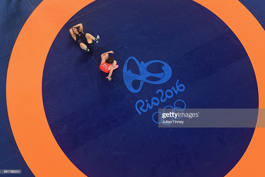 Hafize Sahin of Turkey reacts after being defeated by Inna Trazhukova of Russia during the Women's Freestyle 63 kg 1/8 Finals on Day 13 of the Rio...