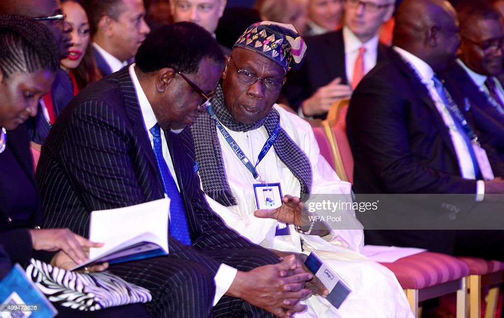 Hage Geingob, President of Namibia (left) with Olusegun Obasanjo, former president of Nigeria (right) during the London Global African Investment Summit at St James' Palace on December 1, 2015 in London, England.