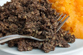Traditional Scottish haggis and neeps close up, also called a burns supper. Served on or around January 25th.
