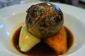 Haggis, the classic Scottish dish, traditionally addressed and eaten on Burn's night.