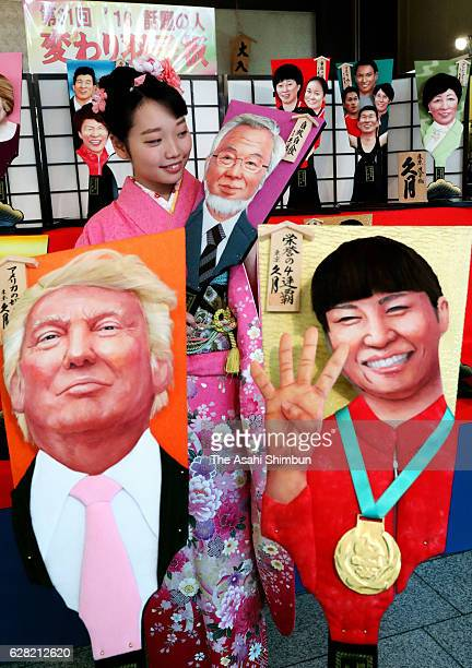 'Hagoita' paddles decorated with people of the year including Donald Trump the US presidentelect and Kaori Icho a gold medalwinning wrestler at the...