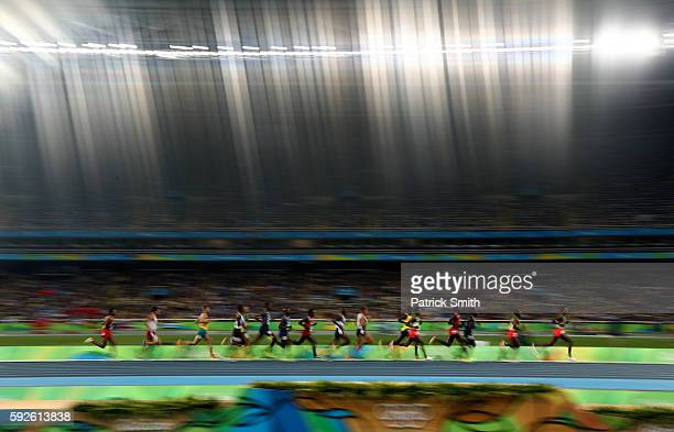 Hagos Gebrhiwet of Ethiopia leads the pack in the Men's 5000m Final on Day 15 of the Rio 2016 Olympic Games at the Olympic Stadium on August 20 2016...