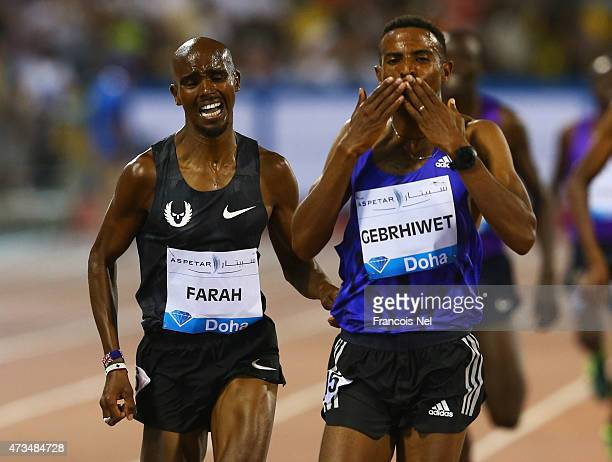 Hagos Gebrhiwet of of Ethiopa finishes ahead of Mo Farah of Great Britain to win the Men's 3000m during the Doha IAAF Diamond League 2015 meeting at...