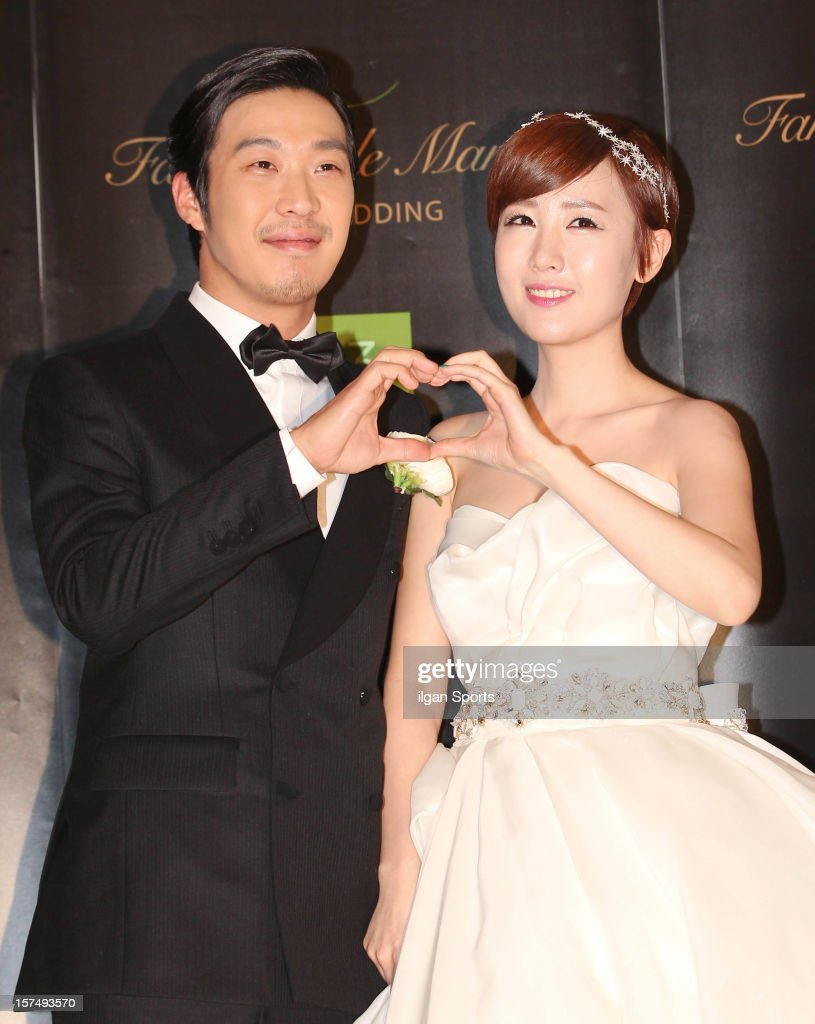 HaHa and Byul pose for photographs before their wedding ceremony at 63 Building convention center on November 30, 2012 in Seoul, South Korea.