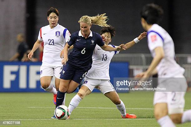 Hahnul Kwon of Korea trips Amandine Henry of France during the FIFA Women's World Cup Canada 2015 round of 16 match between France and Korea Republic...