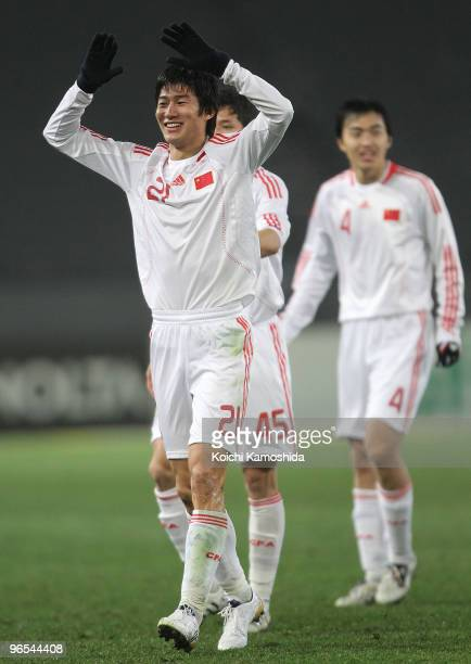 Hai Yu of China celebrates his goal with teammate Bo Qu during the East Asian Football Championship 2010 match between China and South Korea at...