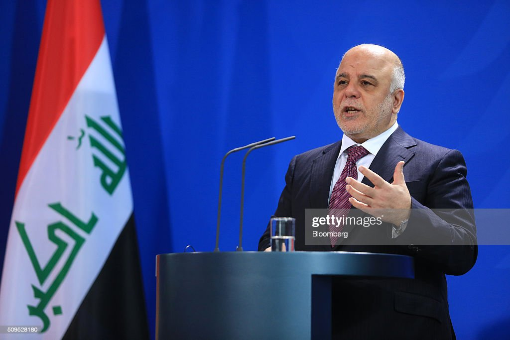 Haidar al-Abadi, Iraq's prime minister, gestures as he speaks during a news conference inside the Chancellory in Berlin, Germany, on Thursday, Feb. 11, 2016. Abadi said the decline in crude prices has been 'very strong' and nobody could have expected how quickly they would fall. Photographer: Krisztian Bocsi/Bloomberg via Getty Images