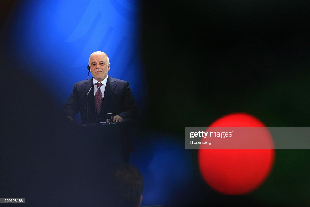 Haidar al-Abadi, Iraq's prime minister, looks on during a news conference inside the Chancellory in Berlin, Germany, on Thursday, Feb. 11, 2016. Abadi said the decline in crude prices has been 'very strong' and nobody could have expected how quickly they would fall. Photographer: Krisztian Bocsi/Bloomberg via Getty Images