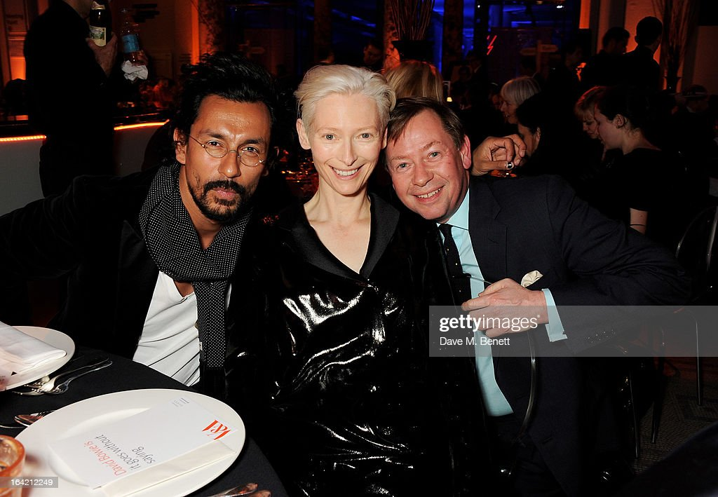 (L to R) Haider Ackerman, Tilda Swinton and her brother Sandy Swinton attend the dinner to celebrate The David Bowie Is exhibition in partnership with Gucci and Sennheiser at the Victoria and Albert Museum on March 19, 2013 in London, England.