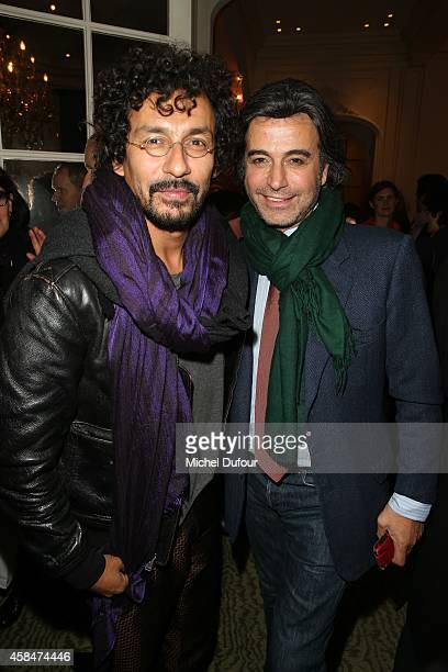 haider Ackermann and Alexandre Zouari attend the 'Loulou de la Falaise' book signing on November 5 2014 in Paris France