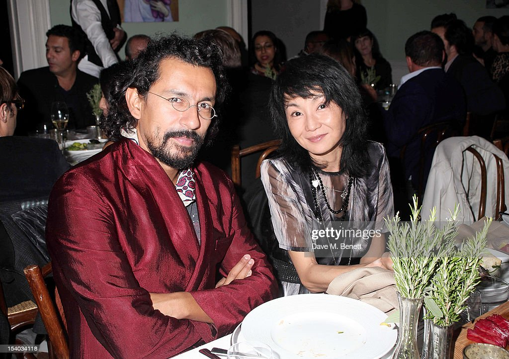 Haider Ackermann (L) and <a gi-track='captionPersonalityLinkClicked' href=/galleries/search?phrase=Maggie+Cheung&family=editorial&specificpeople=210793 ng-click='$event.stopPropagation()'>Maggie Cheung</a> attend the Instanbul'74 dinner celebrating artist Sandro Kopp's 'Mediated Presence' exhibtion at 6 Fitzroy Square on October 12, 2012 in London, England.