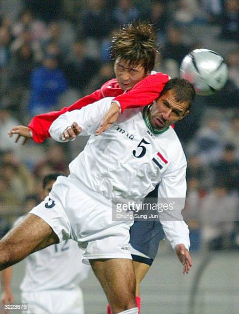 Haider Ahmed of Iraq battles with a South Korean player during the South Korea and Iraq National Olympic team friendly football match at the World...