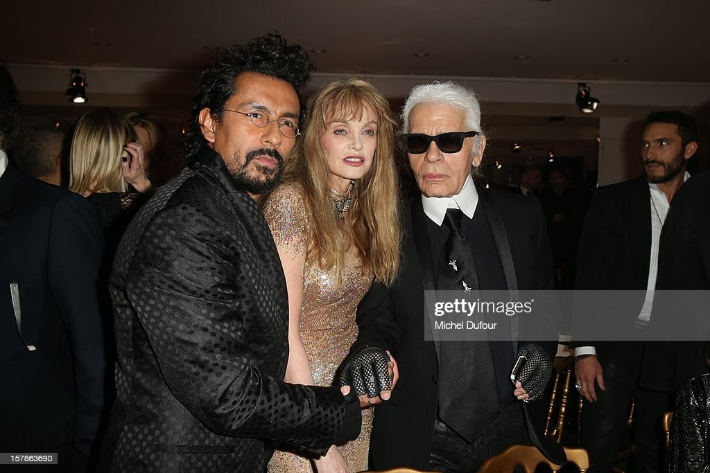 Haider Akermann, Ariel Dombasle and Karl Lagerfeld attend the Babeth Djian Hosts Dinner For Rwanda To The Benefit Of A.E.M. on December 6, 2012 in Paris, France.