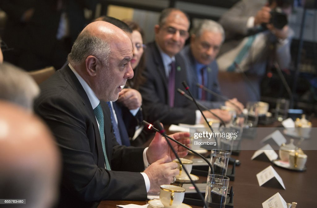 Haider al-Abadi, Iraq's prime minister, left, speaks during a meeting with U.S. President Donald Trump, not pictured, at the White House in Washington, D.C., U.S., on Monday, March 20, 2017. Trump used a White House meeting with al-Abadi to criticize both his immediate predecessors' military strategies in the country. Photographer: Chris Kleponis/Pool via Bloomberg