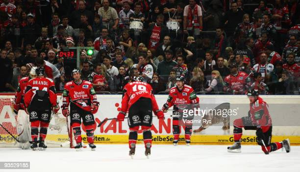 Haie players look dejected after conceding the 56 goal at the extra time during the Deutsche Eishockey Liga game between Koelner Haie and Hannover...