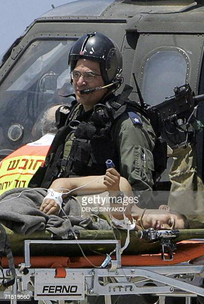 A wounded Israeli soldier ferried into the Rambam hospital in the northern Israeli coastal city of Haifa 26 July 2006 Some 20 Israeli soldiers were...
