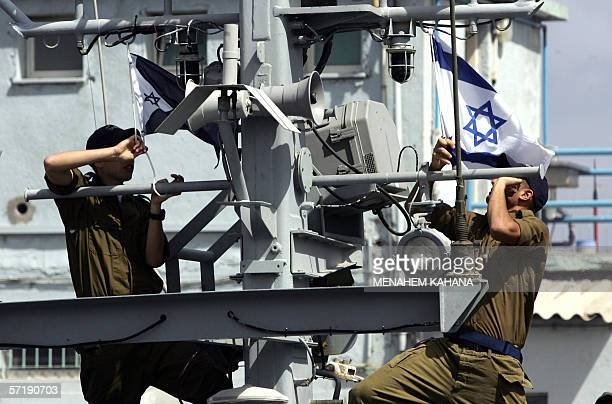 Israeli sailors raise the national and navy flags as they ready to go out on patrol on the 'Devora' gunship from their base in the portal city of...