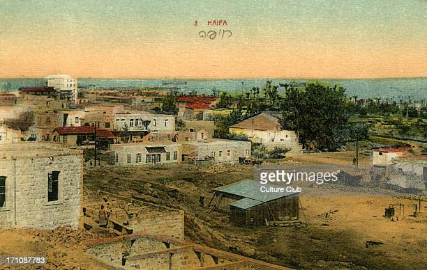 Haifa / Low built buildings overlooking the sea Postcard early 20th century