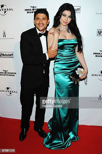 Haifa Wahbi and guest attend the ''Inglourious Basterds' after party at Baoli during the 62nd Annual Cannes Film Festival on May 20 2009 in Cannes...