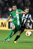 Haifa's Israeli midfielder Shlomi Azulay and Paok's defender Greek Stelios Kitsiou vies for the ball during the UEFA Europa League group L football...