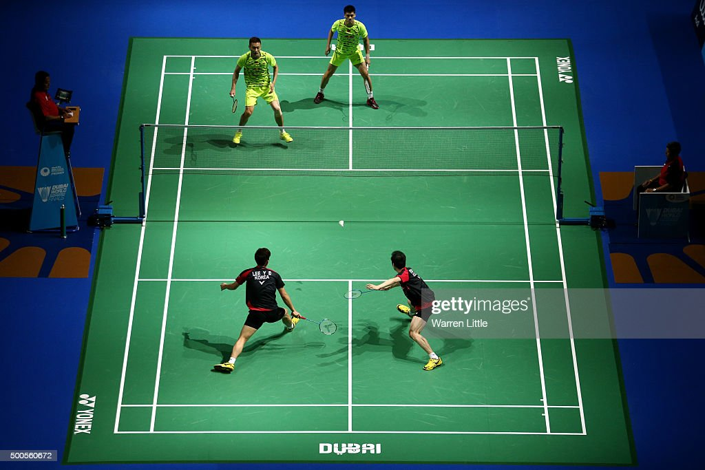 <a gi-track='captionPersonalityLinkClicked' href=/galleries/search?phrase=Haifeng+Fu&family=editorial&specificpeople=647789 ng-click='$event.stopPropagation()'>Haifeng Fu</a> and Nan Zhang of China in action against Yong Dae Lee and Yeon Seong Yoo of Korea in the Men's Doubles match during day one of the BWF Dubai World Superseries 2015 Finals at the Hamdan Sports Complex on on December 9, 2015 in Dubai, United Arab Emirates.